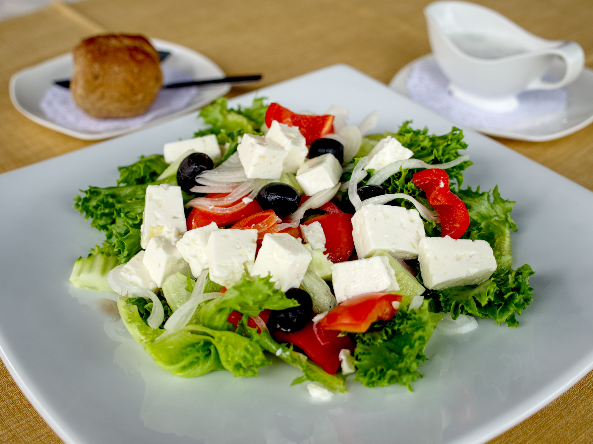 greek salad with bread and dresssing