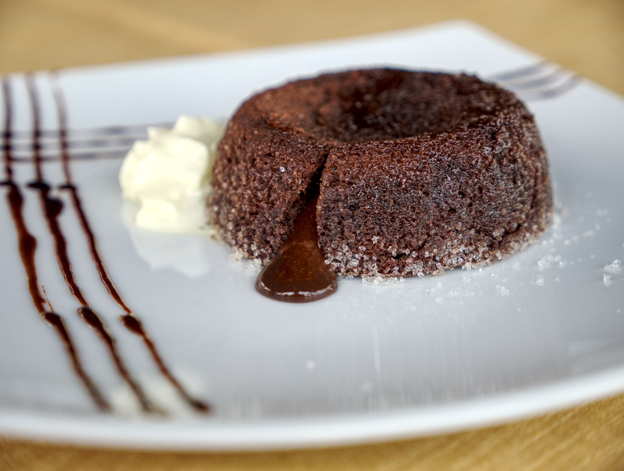 photograph of baked lava cake dessert opened with sauce