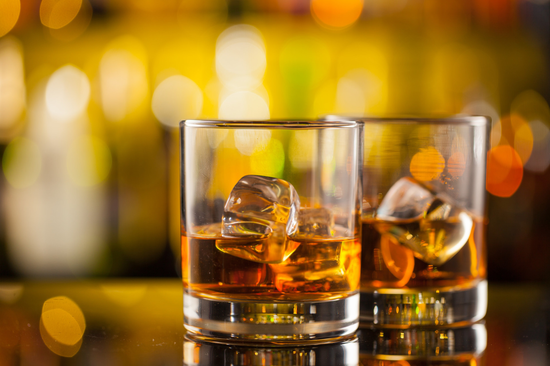 photo of 2 glasses of whiskey on the rocks